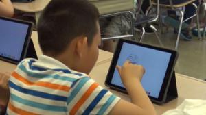 PS2小学实验苹果科技入校 通过电子科技改革教育