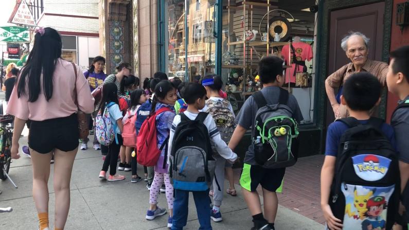 亚裔月伊州府拨款5000万给中国城地区为的是?