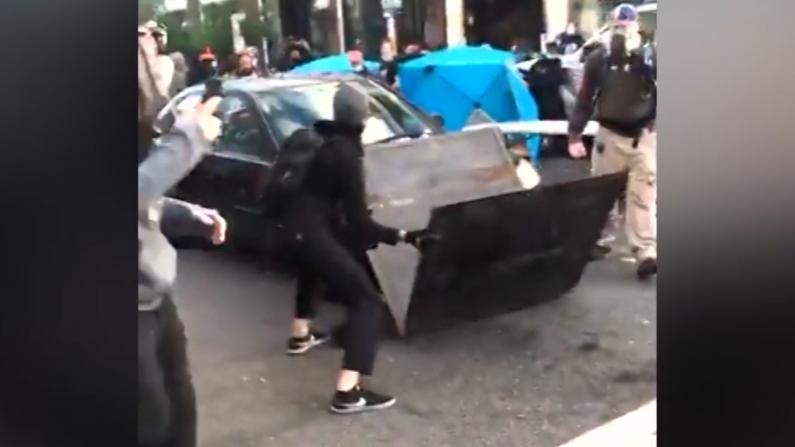 西雅图男子驾车冲撞示威者 开枪击中一人后自首