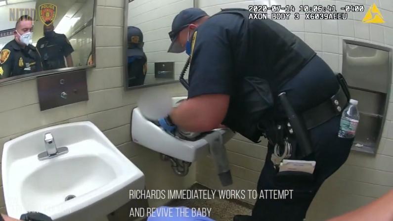一女子突在新泽西车站内分娩 俩警察反应感动所有人