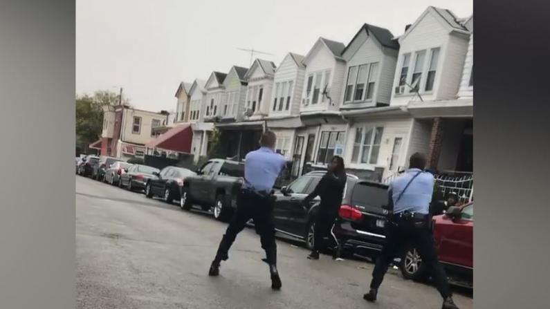 费城警方当街击毙持刀非裔男子引发骚乱 30名警察受伤