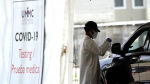 全美新冠确诊病例超900万 卫生官员吁实施更严格防疫措施