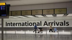 何时解除国际旅行禁令? 白宫这样说