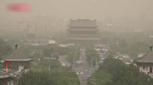 沙尘暴来袭 北京城区被黄沙笼罩 内蒙古现破记录大风