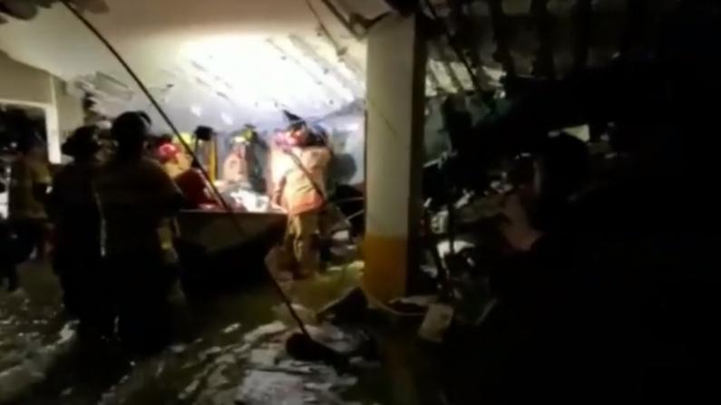 塌方大楼地下车库凿墙搜救 佛州州长宣布紧急状态