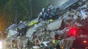 佛州塌楼事故159人仍失踪 救援人员移出遗体 重型机械到场