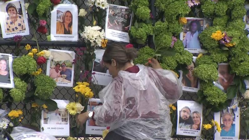亲友聚集迈阿密公寓塌方受害者纪念墙:这是他们活过的证明
