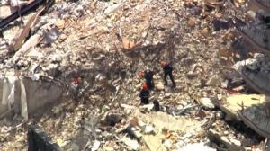 碎砖块坠落拖延迈阿密搜救 专家:幸存者或在16英尺之下