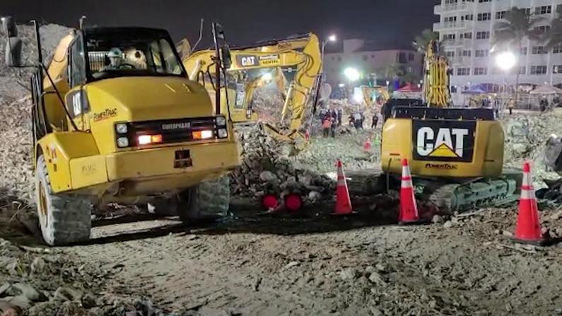 佛州塌楼第18天:挖掘进入废墟下层 被埋车辆已成废铁